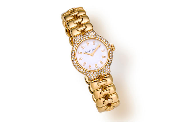 "An eighteen karat gold and diamond ""Tesoro"" bracelet wristwatch, Tiffany & Co."