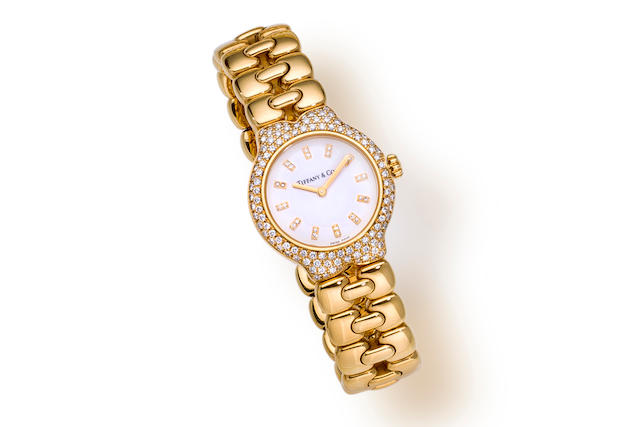 "An eighteen karat gold and diamond ""Tesoro"" bracelet wristwatch, Tiffany & Co."