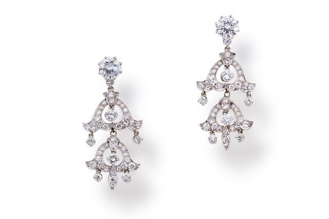 A pair of diamond pendant earrings