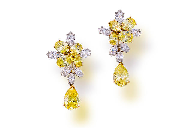 A pair of fancy colored diamond and diamond pendant earclips
