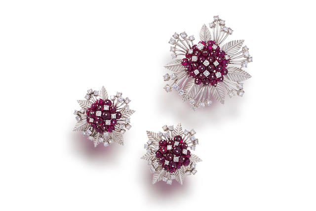A pair of ruby and diamond earclips and a brooch,