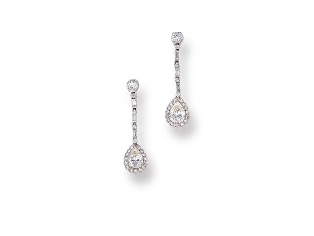 A pair of diamond pendant earclips