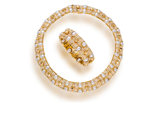 An eighteen karat gold, diamond and cultured pearl necklace and bracelet