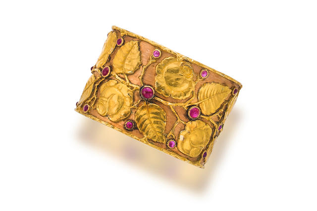 An eighteen karat bicolor gold and ruby bangle bracelet, Buccellati