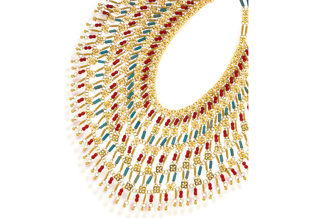 An eighteen karat gold and coral necklace
