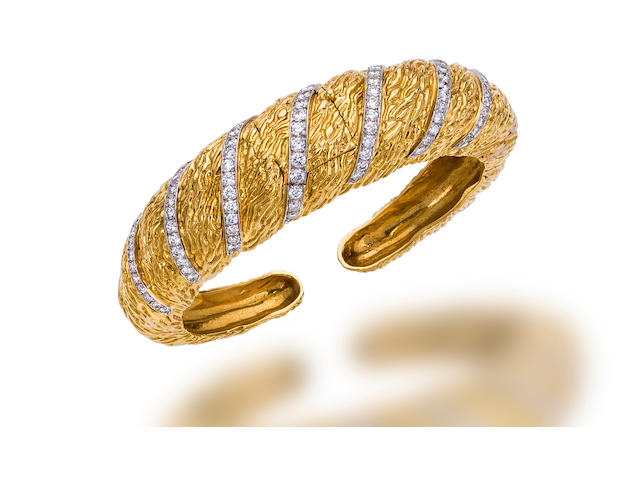 A diamond and eighteen karat gold covered bangle wristwatch,  Laykin et Cie