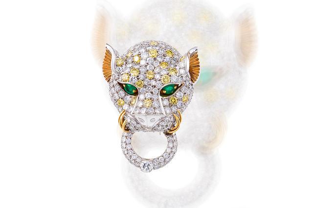 A diamond, colored diamond and emerald brooch