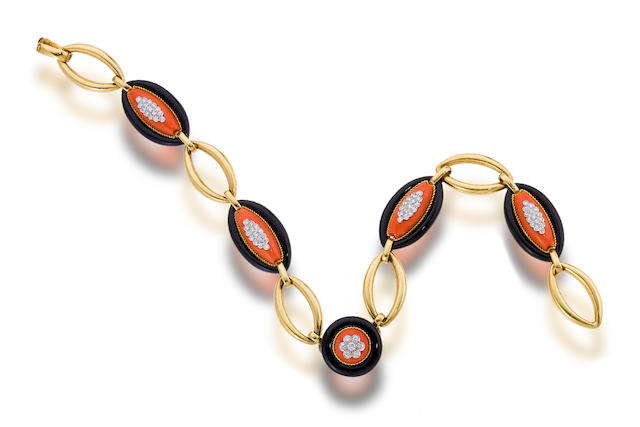 A coral, onyx and diamond necklace