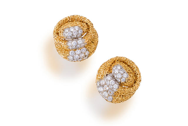 A pair of diamond and eighteen karat gold earclips, David Webb