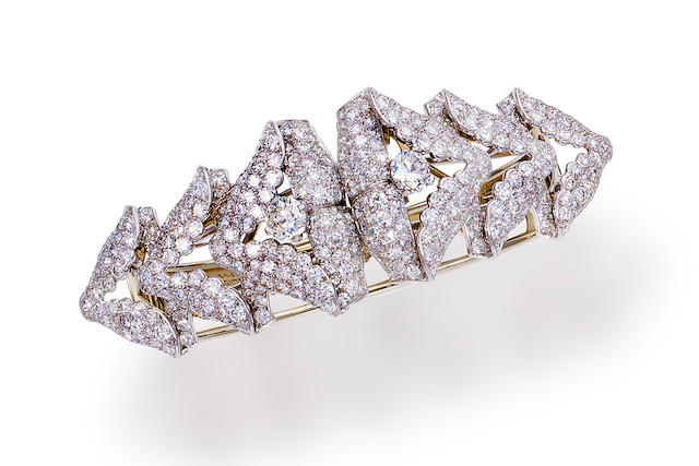A diamond bangle bracelet with pair of brooches, Cartier,