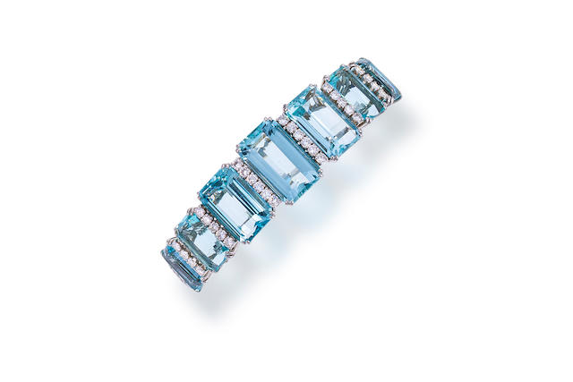 An aquamarine, diamond and fourteen karat white gold bangle bracelet