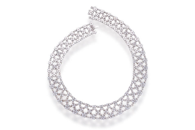 A diamond and eighteen karat white gold necklace,