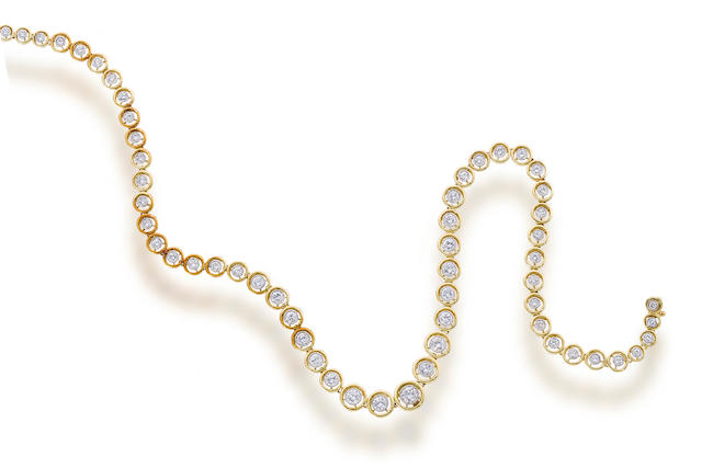 A diamond and eighteen karat gold necklace