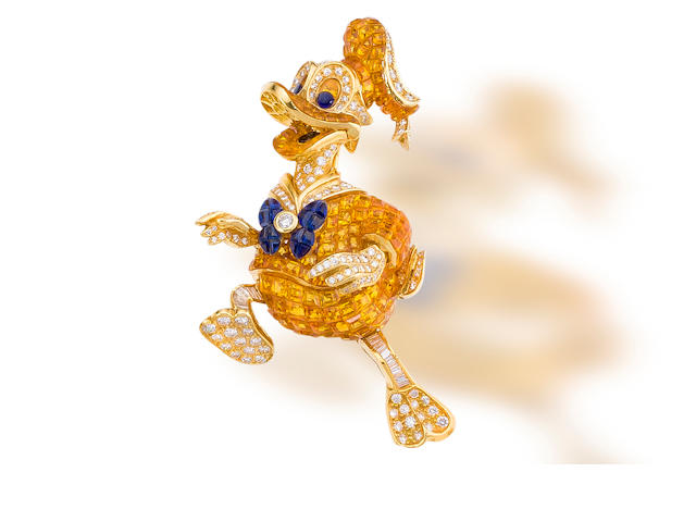 A blue and yellow sapphire and diamond brooch