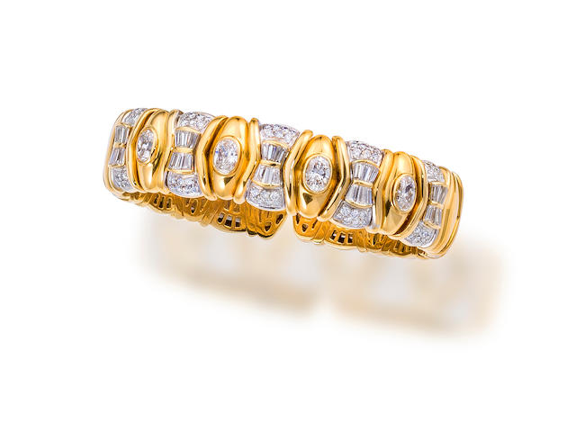An eighteen karat bicolor gold and diamond bangle bracelet