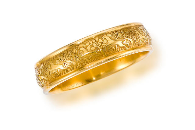 An eighteen karat gold bangle bracelet, Cartier,