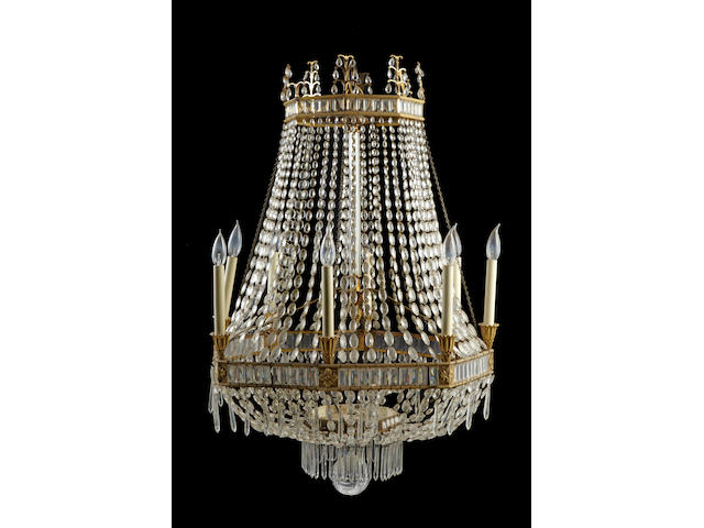 An Empire style gilt bronze and cut glass eight light chandelier possibly Bagues early 20th century