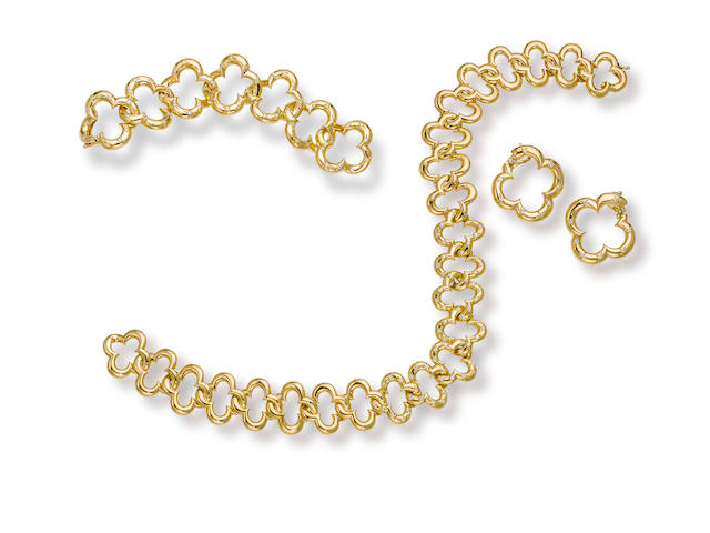 "An eighteen karat gold and diamond ""Alhambra"" suite, Van Cleef & Arpels"