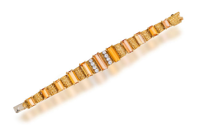 An eighteen karat gold, topaz, and diamond bracelet