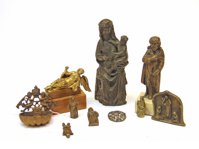 A group of ten gilt and patinated bronze religious figures and articles 16th century through 19th century