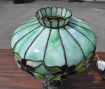 A leaded glass and patinated metal lamp, Attributed to McKenney & Waterbury Company<BR />first quarter 20th century