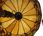 An American leaded glass and patinated metal table lamp Attributed to Chicago Mosaic, first quarter 20th century