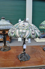 A J.A. Whaley leaded glass and patinated metal table lamp<BR />first quarter 20th century
