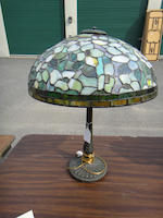 An American leaded glass and patinated-metal table lamp<BR />first quarter 20th century