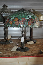 A leaded glass and patinated metal table lamp the shade attributed to Unique Art Glass, the base by Handel first quarter 20th century