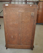 A Gustav Stickley oak single door bookcase<BR />circa 1904