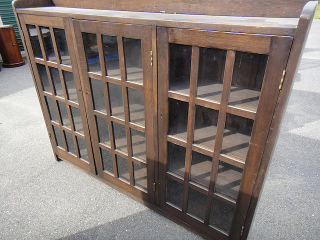 An American Arts and Crafts oak triple door bookcase early 20th century