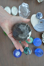 Eighteen miscellaneous glass, marble, carved soapstone or resin paperwieghts