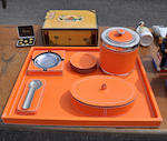 An eleven-piece orange granular leather and chrome mounted smoking set<BR />20th century