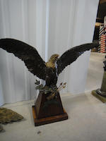 A painted metal figure of a wingspread eagle holding three arrows and a garland late 19th/early 20th century