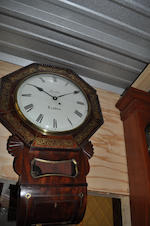 A George IV mahogany and cut brass wall clock<BR />the dial inscribed Newton, London<BR />second quarter 19th century
