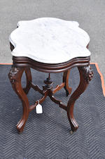 A late Victorian carved walnut and marble top center table circa 1900