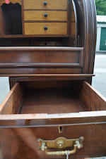 A Victorian brass mounted mahogany cylinder front secretaire<BR />second half 19th century