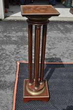 A matched pair of Louis XVI style mahogany and brass mounted columnar form pedestals<BR />late 19th century