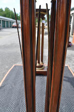 A matched pair of Louis XVI style mahogany and brass mounted columnar form pedestals late 19th century