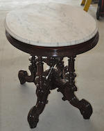 A late Victorian rosewood oval center table with white marble top<BR />circa 1900