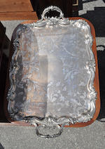 A Sheffield silver plated two handled tray on a later George III style mahogany stand<BR />the tray late 19th century