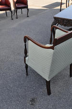 A Federal style mahogany inlaid and upholstered lolling chair<BR />early-mid 20th century