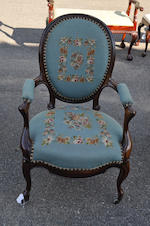 A Victorian Rococo Revival rosewood needlepoint upholstered armchair mid-19th century