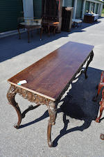 A Rococo style carved walnut library table<BR />early 20th century