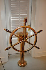 A ship's wheel and pedestal<BR /> late 19th Century