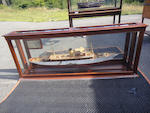 A mirrored back presentation half model of the steam yacht Lyndonia<BR /> 69 x 27-1/4 x 10-1/4 in. (175.2 x 69.2 x 26 cm.) cased.