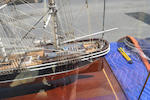 A folk art model of an American clipper ship<BR /> early 20th century 35-1/4 x 26-3/4 x 11-3/4 in. (89.5 x 67.9 x 29.8 cm.) cased.