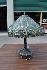 A contemporary Heart Studios leaded glass and patinated metal table lamp