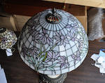 A contemporary leaded glass,  patinated metal and onyx floral table lamp