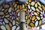 A contemporary leaded glass and patinated metal boudoir lamp